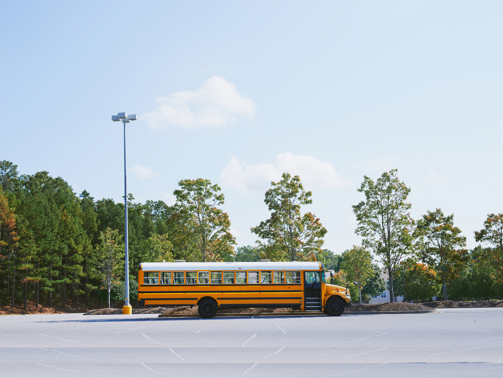 American School Bus waiting in a parking lot