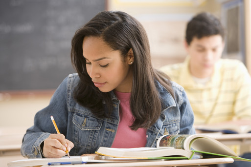 High School Student Taking Notes in Class --- Image by © Royalty-Free/Corbis